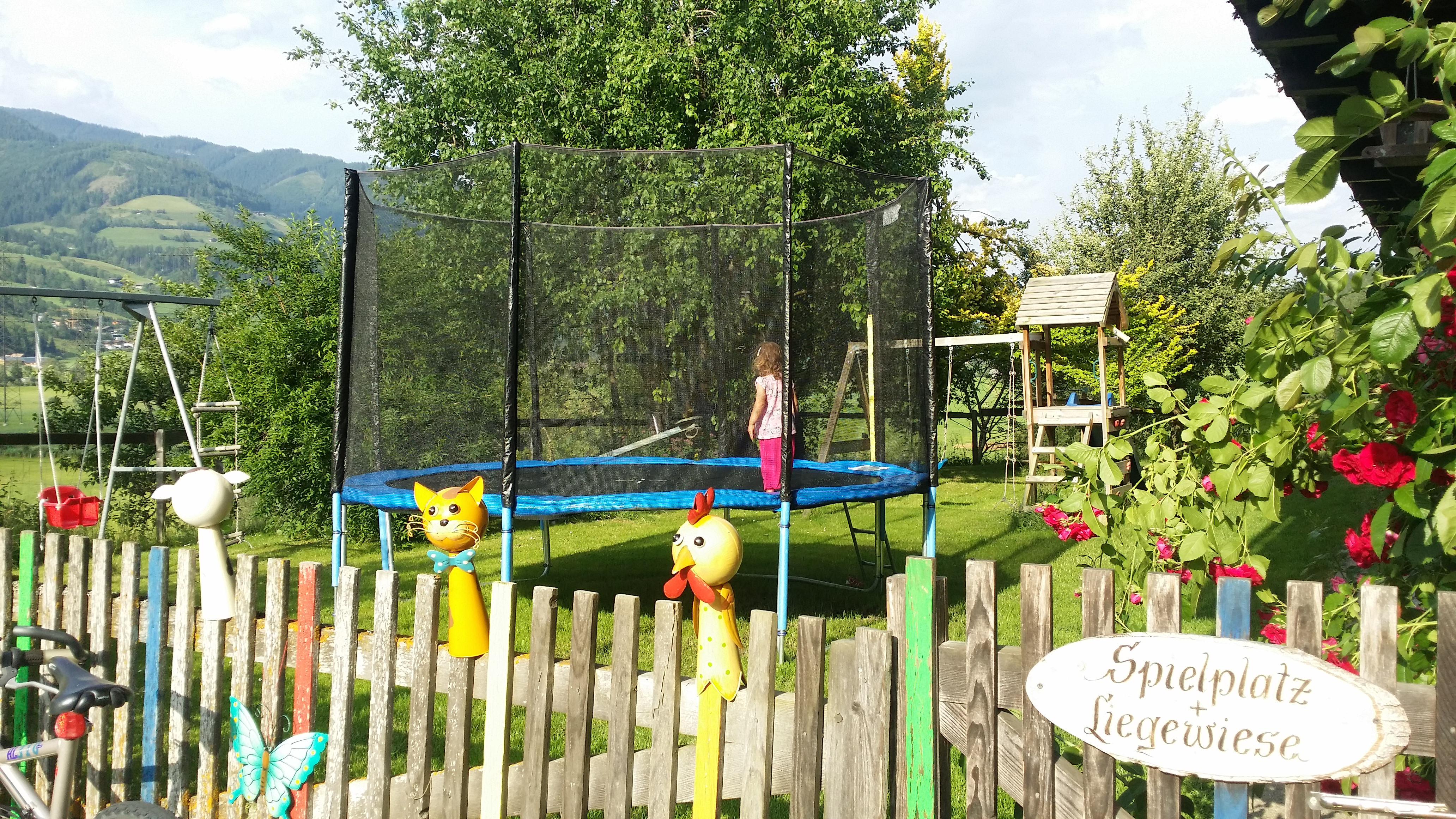 Playground, play room and garden with sun beds
